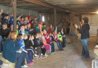 School group learning in barn