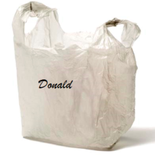 Plastic sack labeled with name